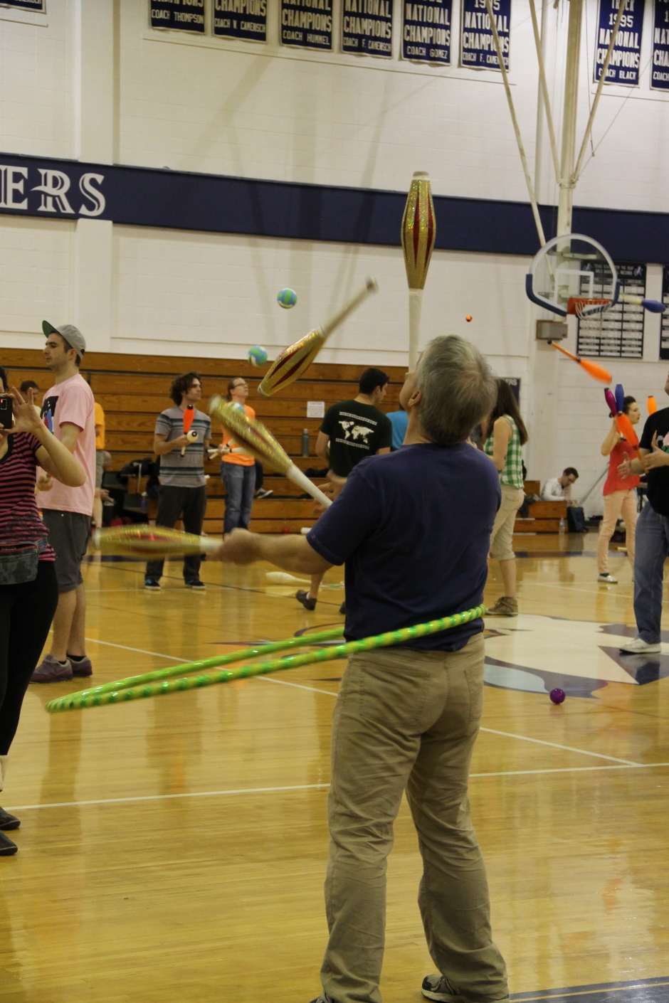 Juggling and hula hooping with a balance